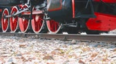 heavy : Old locomotive wheels close up. Detail of steam locomotive, side profile view, wheels, rods. Stock Footage
