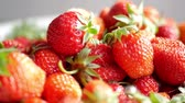 lanches : Red ripe organic strawberries on market counter. Strawberry background.