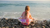 koşu : Little girl happily playing with waves at the beach. Stok Video