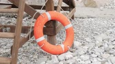 sos : Rescue buoy on the beach. Lifebuoy. Stok Video