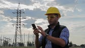 industrial background : Engineer electricity use phone during sunset