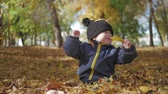 outubro : Happy little child, baby boy laughing and playing in the autumn in the park walk outdoors. Stock Footage