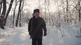 Hunter walking in the snowy winter forest. Winter hobby, sun, hunting concept. Stock Footage