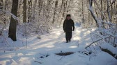 Hunter walking in the snowy winter forest. Winter hobby, sun, hunting concept. Dostupné videozáznamy