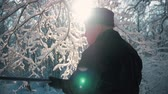 hunters : Hunter walking in the snowy winter forest. Winter hobby, sun, hunting concept. Stock Footage