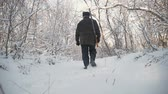 fotografando : Hunter walking in the snowy winter forest. Winter hobby, sun, hunting concept. Stock Footage