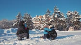 padre : Father, mother and two children are having fun and playing on snowy winter walk in nature. Happy family at outdoor.