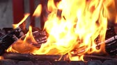 Panoramic video of open fire in iron barbecue stove