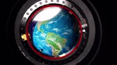 universe inside : View from a porthole of space station the Earth.
