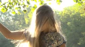 windy : Close up portrait of beautiful young woman. Girl playing with her hair in the sunlight. Slow Motion 100 FPS.