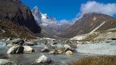 vale : Panorama of the Himalayan mountains. Creek flowing from the glacier. 4K