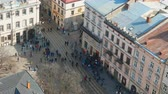lviv : Crowds of people walking in the city with tram traffic. Aerial view over the streets of Lviv, Ukraine. Time lapse 4K Stock Footage