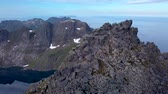Aerial view of tourists on peak of a high mountain. Lafoten islands. Norway 4k Stock Footage