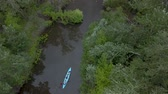 canoe : Aerial view of kayak floats along a calm river among the trees