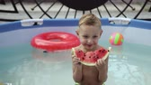 kavun : Boy in black glasses eats watermelon in the pool