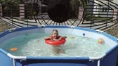 innenraum : The boy floats on an inflatable pool in the pool