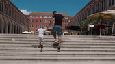 notas : The father and his son have fun climbing up the stairs on Splits square. Croatia Vídeos