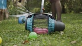 střih : Roll tool that collects balls in the park. Roll tool for collecting apples and balls