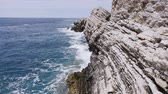 hırvatistan : Beautiful sea waves spatter the rocks in summer day. Adriatic sea Stok Video
