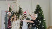 social event : general plan. on the dancing young people of different races flutches confetti. beautiful girls and boys are celebrating the new year and Christmas and they are shining with a brilliant confetti Stock Footage