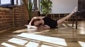 sukénka : Young ballerina doing stretching sitting on a floor. Gymnast for training. Attractive girl in black tutu is doing workout at the ballet school. Professional dance, ballerina, gymnast, stretching