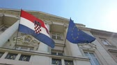 croata : the croatian and the european flags on the croatian parliament building in Zagreb