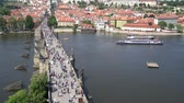 charles bridge : tourists walk on the Charles bridge in Prague, Czech Republic
