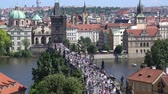 most : tourists walk on the Charles bridge in Prague, Czech Republic