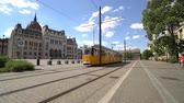 person : A tram runs in Kossuth Square in Budapest, Hungary