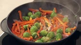 small : Red Paprika, Brussel Sprouts and Onions Frying on a Pan HD