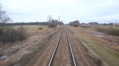 long distance : Railroad track running through coutry landscapes Stock Footage