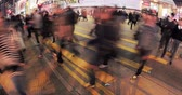 travel : Time lapse video of fast moving pedestrians crossing busy road by street crosswalk in downtown of Hongkong. City rush hour scene Stock Footage