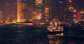 mroczne : Tourist boat in Victoria harbor and lights of night city in Hong Kong downtown