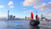 landmark : Hong Kong panoramic cityscape view and tourist boat in Vicoria harbor Stock Footage