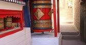 calm : Traditional art and culture in Buddhist temple decoration. Spinning prayer wheel in Ladakh monastery in India