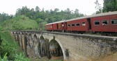 klenba : Sri Lanka train crossing old beautiful 9 Arches Bridge in Ella highlands. British architecture landmark in Asia