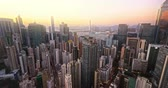 iluminado pelo sol : Hong Kong harbor view at sunset. Panoramic skyline cityscape aerial landscape