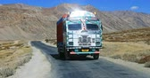 ladakh : Traffic in Himalaya mountains, traditional indian decorated truck drives in remote region of Ladakh, north India
