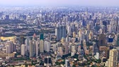 Flying above Bangkok in Thailand.. Beautiful aerial panorama of urban skyscrapers and houses seen until the horizon from airplane