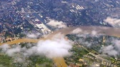 voar : Flying above Bangkok, Thailand. Aerial view of Chao Phraya river through layer of clouds