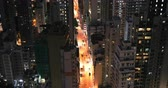hong kong skyline : City street at night with car and apartment buildings windows lights aerial view from above downtown roofs
