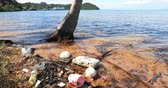 Plastic garbage floating on coast. Polluted ocean background