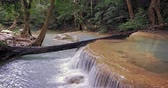 平和 : Cascades of waterfalls hidden in tropical forest. Clean fresh water flows through asian jungle 動画素材