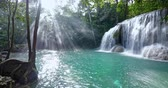 cataratta : Rays of sun light and waterfall in tropical jungle forest at morning. Amazing rainforest nature Filmati Stock