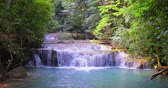 고요한 장면 : Waterfall cascades in rainforest of Thialand. Beautiful nature landscape