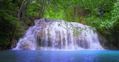 szűz : Scenic waterfall in tropical forest. Amazing nature background Stock mozgókép