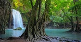 virgem : Amazing nature of Thailand. Waterfall and tree with large roots in beautiful jungle forest