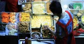 wan : Local Vendor Sells Traditional Asian Food And Snacks At Night Market. Tasty Meal Stock Footage
