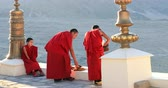 cultural tradition : Buddhist monks in red robes in Thiksey monastery in Ladakh, India, Himalaya region. Traditions and culture scene Stock Footage