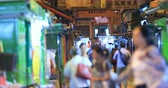ingázó : Defocused blurred people silhouettes walk on street of Hong Kong in Wan Chai downtown district. Urban scene video background